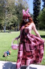 Phoebe Price Wears a face mask as she gets ready to celebrate Easter