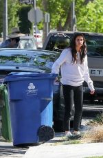 Sara Sampaio Steps out to get a few trash bins back inside her place in Los Angeles