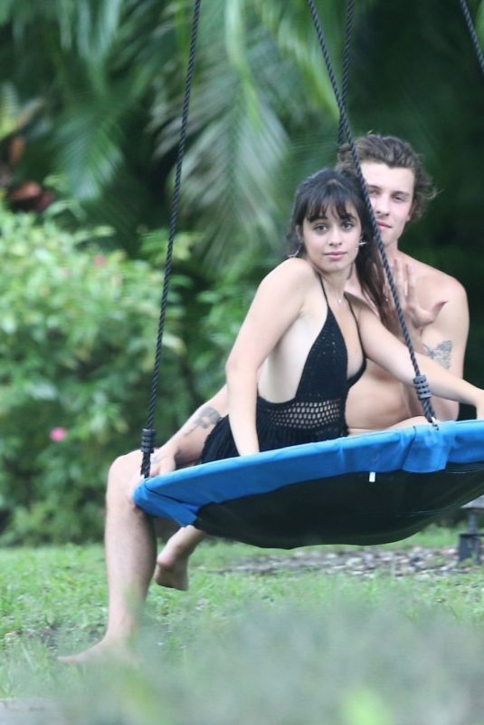 Shawn Mendes and Camila Cabello having a romantic time on a swing