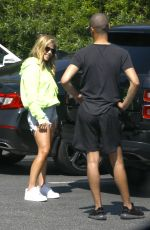 Tracy Tutor Shows off her incredible legs as she socially distances from a hunky guy on a shopping run in Beverly Hills