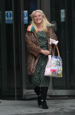 Vanessa Feltz Shows weight loss effects while leaving BBC studios in animal print coat and floral dress in London