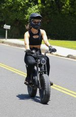 Amelia Hamlin Takes a ride on her electronic bike in Beverly Hills