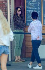 Amy Landecker Wears a mask as she waits in line for coffee at Alfred