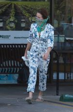 Andie MacDowell Slips on a bandana as a face mask while dropping articles off at a dry cleaner in Los Angeles