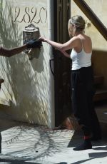 Ashley Benson Receiving order at home in Los Angeles