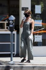Ashley Tisdale Wearing mask as she takes her time while grabbing a coffee in Los Angeles
