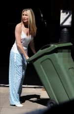 Caprice Bourret Taking the bins out in London