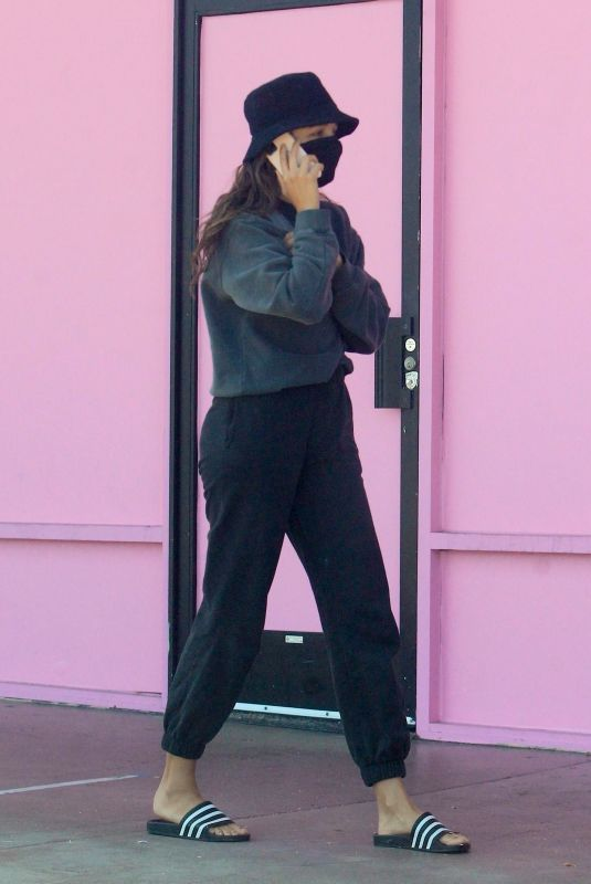 Chantel Jeffries Tries to hide from the camera during a walk in West Hollywood