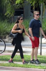 Claudia Romani and Chris Johns enjoy a walk together in Miami Beach