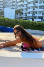 Claudia Romani Celebrating her birthday by the pool