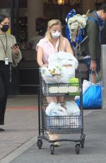 Corinne Olympios Wears a mask shopping at Ralphs in West Hollywood