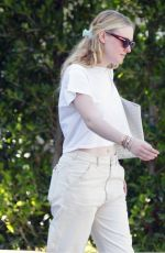 Dakota Fanning Moving boxes from her car into a home with a friend in Los Angeles