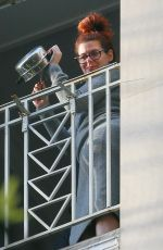 Debra Messing Out on her balcony in New York