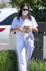 Emmy Rossum Dropping off cookies to a neighbor in LA