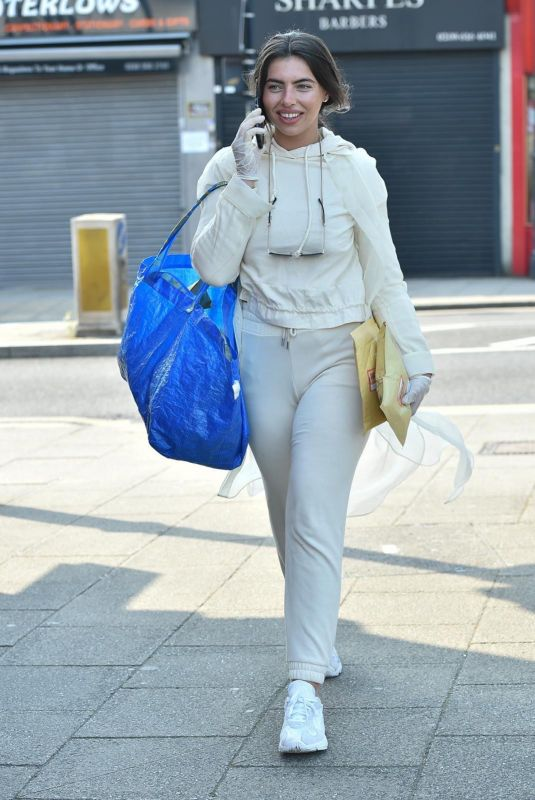 Francesca Allen Wears surgical gloves as she heads to the post office to post online orders from her fashion boutique Bonnie and Clyde