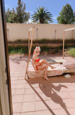 Frenchy Morgan Spends quarantine on her cell phone and tanning in her garden in Las Vegas