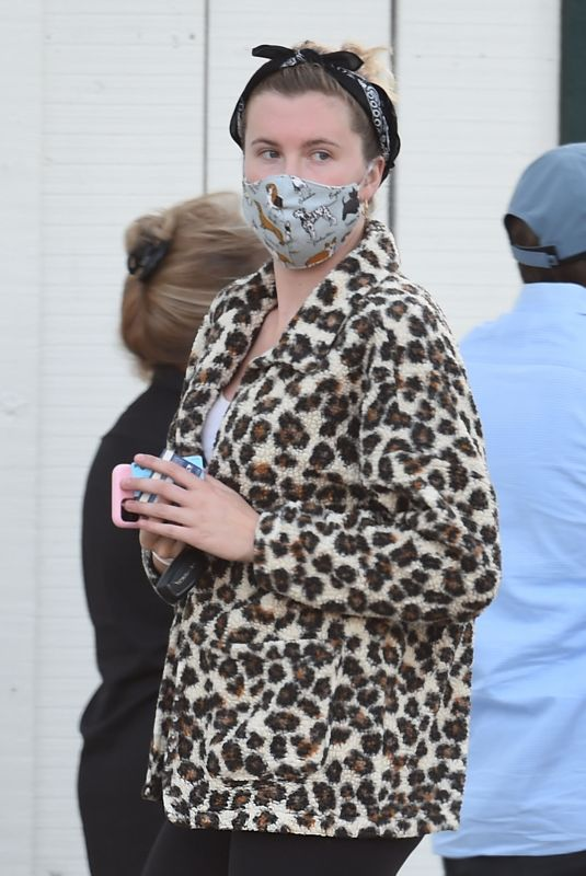 Ireland Baldwin Wearing a face mask with dog prints whilst grocery shopping at Whole Foods in Los Angeles