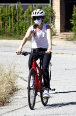 Isla Fisher Riding her bike in the Hollywood Hills