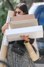 Jenna-Louise Coleman Carrying a big pile of delivery boxes as she make her way to the post office in London