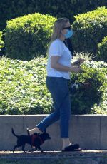 Kaitlin Doubleday Braves the heat to take her dog for a walk in Beverly Hills