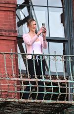Karlie Kloss and Joshua Kushner share a kiss on their balcony of their New York City
