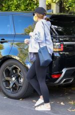 Katherine Schwarzenegger Covers her baby bump and face with a mask as she visits her mother Maria Shriver in Brentwood
