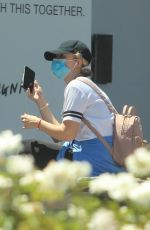 Kathryn Newton Kicks back with a protective mask on while out in Beverly Hills