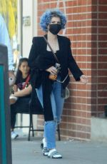 Kelly Osbourne Shows off her new vibrant blue curly hairstyle on a lunch outing with mystery man in Los Angeles