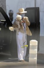 Kristin Chenoweth Wears a mask as she brings her furry friend along for some grocery shopping at Ralphs in West Hollywood