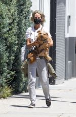Lady Victoria Hervey Wears a mask while out for a walk with her dog in West Hollywood