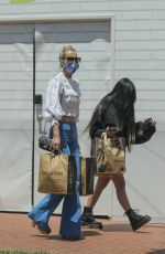 Laeticia Hallyday Shows off her toned abs while out shopping for groceries with her daughter in Pacific Palisades