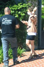 Lily Collins Chats with a maintainance man working on her broken gate in Los Angeles