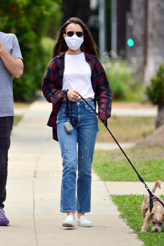 Lily Collins Steps out for an afternoon stroll with her dog in Beverly Hills