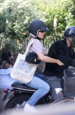 Lily-Rose Depp and Samuel Benchetrit riding motorcycle in Paris