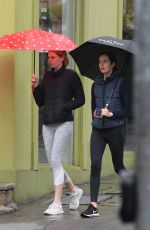 Lucia Hawley Spotted out with a friend grabbing coffee in the rain in Paddington in Sydney