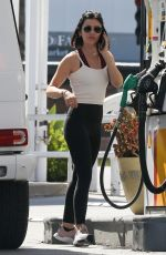 Lucy Hale Pumping gas in Beverly Hills