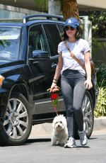 Lucy Hale Taking her dog Elvis for a walk in her cozy neighborhood this afternoon