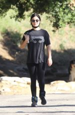 Lucy Hale Wears an Alabama concert tee with leggings and ankle weights for a hike with a friend in Hollywood Hills