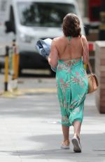 Lucy Horobin Pictured while leaving Global Radio wearing clinging floral jumpsuit