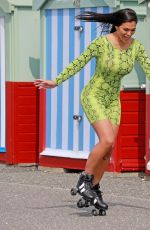 Lydia Clyma In a bright green snakeskin outfit as she seen enjoying some rollerblading in the sunshine in Portsmouth