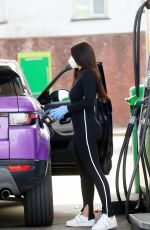 Lydia Clyma Takes no risks as she fills up her car at her local petrol station