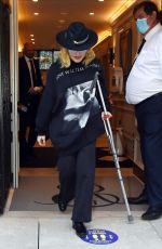 Madonna Looked in good spirits despite her injury as she was seen in London