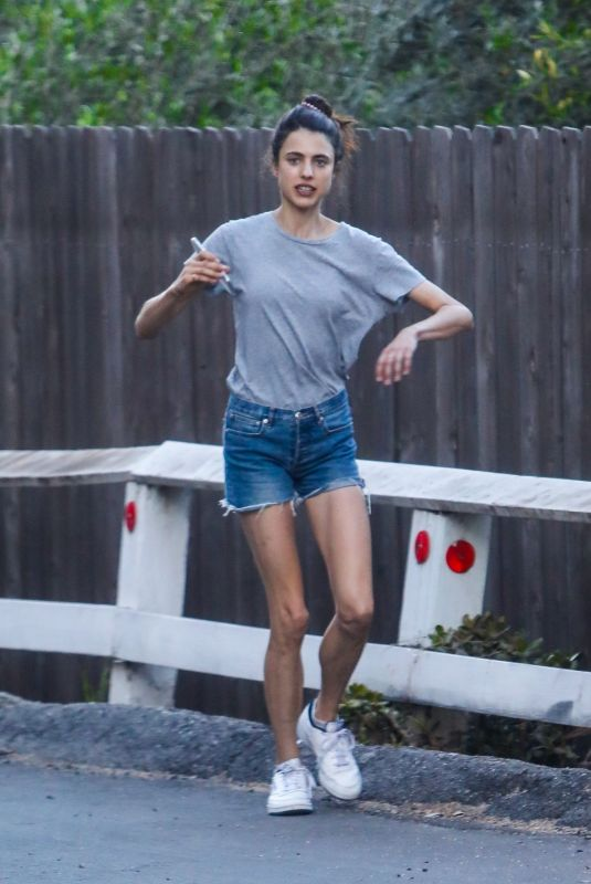 Margaret Qualley Seen talking on her phone during her daily walk in Los Angeles