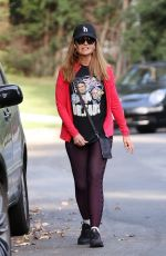 Maria Shriver Wears a Dr. Fauci t-shirt as she walks around her neighborhood in Brentwood