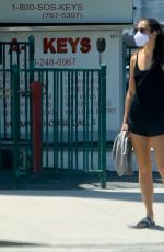 Mercedes Mason Waits patiently at a red light as she goes for a walk in West Hollywood