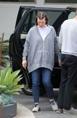 Milla Jovovich and family arrive at a friends house in LA