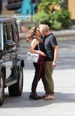 Myleene Klass and Simon Motson put on a romantic display as he drops her off at Global offices