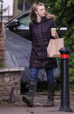 Natalie Dormer Waiting in line for her lunch and coffee with dog