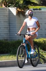 Nicole Murphy Wears a mask and crop top as she goes out for a bike ride in Santa Monica