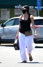 Nikki Bella Shows her growing baby bump while grocery shopping in Los Angeles